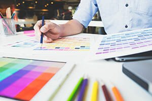 graphic designer at work color swatch samples